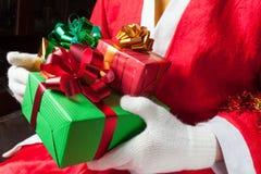 Santa Claus holding gifts Royalty Free Stock Image