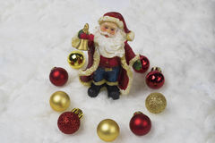 Santa claus is holding a handbell. Royalty Free Stock Photos
