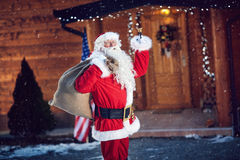 Santa Claus holding his bag and ringing a bell it`s Christmas Stock Photo
