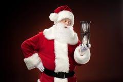 Santa Claus holding hourglass Stock Photo