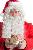 Santa Claus holding house Stock Photography