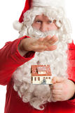 Santa Claus holding house Stock Photos