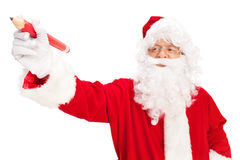 Santa Claus holding a huge red pencil Stock Photos