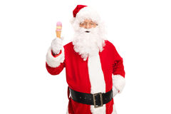 Santa Claus holding an ice cream cone Stock Images