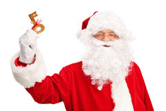 Santa Claus holding a key wrapped with red ribbon Royalty Free Stock Images