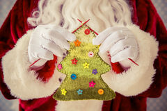 Santa Claus holding knitted Christmas tree Stock Photography