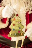 Santa Claus holding knitted Christmas tree Royalty Free Stock Photography