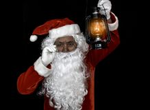 Santa Claus holding lantern for lighting studio shot on black background for family, giving, season, Christmas, holiday, new year,. Travel, Christian and royalty free stock photography