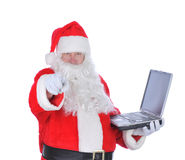 Santa Claus Holding Laptop Pointing Stock Photography
