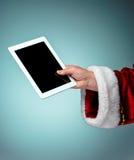 Santa Claus holding laptop Royalty Free Stock Photo