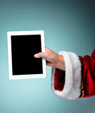 Santa Claus holding laptop Royalty Free Stock Photography