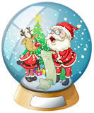 Santa Claus holding a list inside the snow ball with a reindeer Royalty Free Stock Image