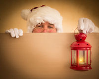 Santa Claus holding magic lantern. And banner blank. Christmas holiday concept Royalty Free Stock Photo