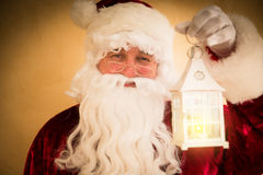 Santa Claus holding magic lantern Stock Photo