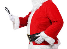 Santa Claus holding a magnifying glass Royalty Free Stock Photos