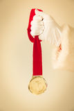 Santa Claus holding medal Stock Photos