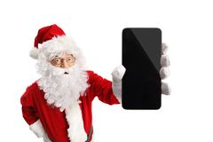 Santa Claus holding a mobile phone royalty free stock photos