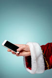 Santa Claus holding mobile smartphone ready for Christmas time Stock Photos