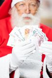 Santa Claus Holding Money Stock Foto