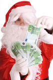 Santa Claus holding money. Stock Image
