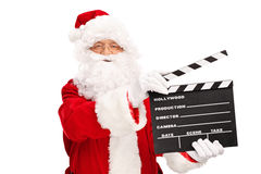 Santa Claus holding a movie clapperboard Stock Photography