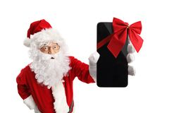 Santa Claus holding a phone with a red ribbon royalty free stock photography