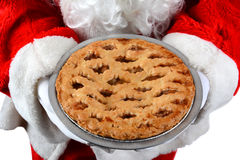 Santa Claus Holding Pie Stock Images