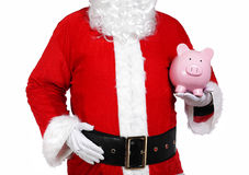 Santa Claus holding a piggy bank Stock Images