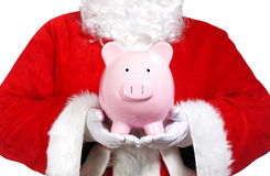 Santa Claus holding a piggy bank Royalty Free Stock Image