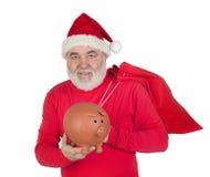 Santa Claus holding a piggybank. Isolated on white background Royalty Free Stock Photo