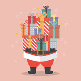 Santa Claus holding a pile of gift boxes Royalty Free Stock Photo