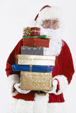 Santa Claus Holding Pile Of Gift Wrapped Presents Stock Photos