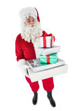 Santa claus holding pile of gifts Royalty Free Stock Photo