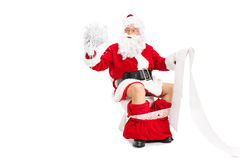 Santa Claus holding a pile of shredded paper Royalty Free Stock Photos