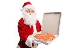 Santa Claus holding a pizza box royalty free stock photos