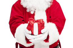Santa Claus holding a present Stock Photo