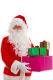 Santa Claus holding presents. Stock Images