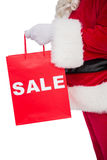 Santa claus holding sale bag Stock Images