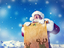 Santa Claus Holding Scroll Concepts Royaltyfria Foton