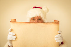 Santa Claus holding scroll paper blank Royalty Free Stock Photography