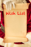 Santa Claus holding scroll paper blank. In hands. Christmas holiday concept Stock Photography