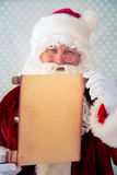 Santa Claus holding scroll paper blank Stock Photos