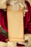 Santa Claus holding scroll paper blank Stock Images