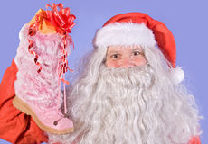 Santa Claus holding a shoe Stock Images
