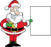 Santa Claus Holding a Sign Royalty Free Stock Image