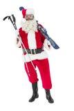 Santa claus holding ski and ski poles Stock Images