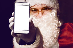 Santa Claus holding smartphone Stock Image