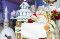 Santa Claus holding a Snowman Royalty Free Stock Photos