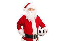 Santa Claus holding a soccer ball Royalty Free Stock Photography