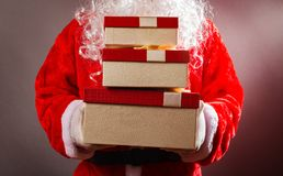 Santa Claus holding gift boxes. Santa Claus holding some gift boxes Royalty Free Stock Image